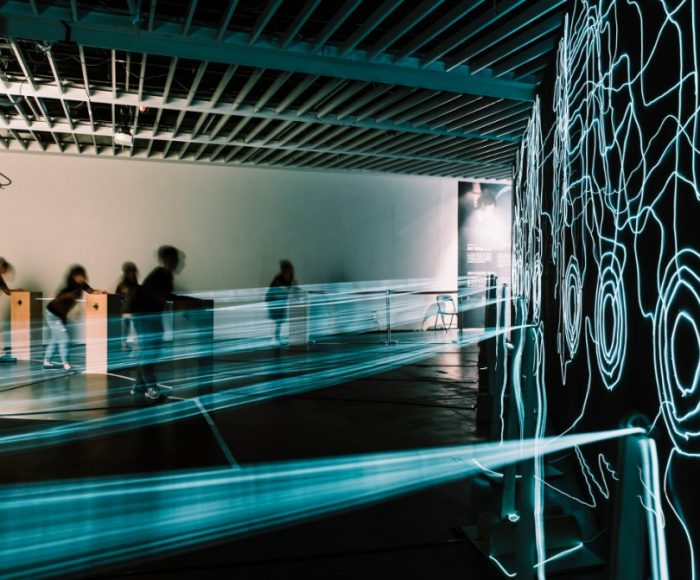 Children pressing buttons to interact with Kasia Molga's artwork Positively Charged in Taipei