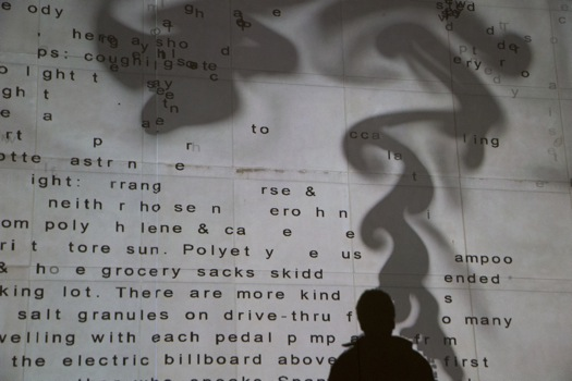 text-based image projected onto a wall